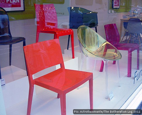 Plastic chairs in a department store window