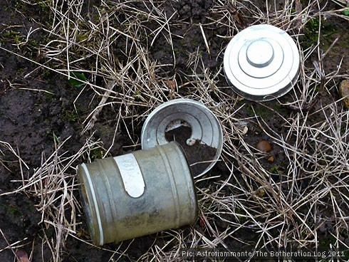 Jar with metal lid abandoned on allotment plot