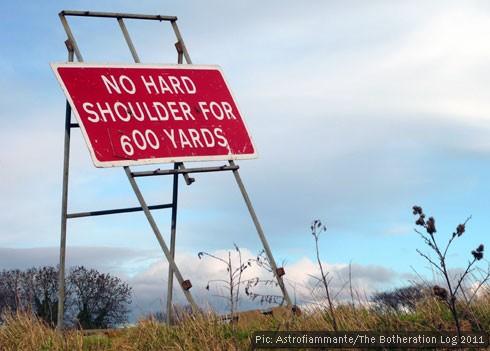 Red motorway sign indicating no hard shoulder for 600 yards