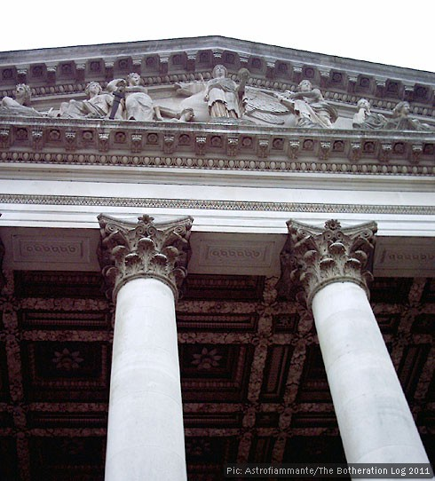 Classical frontage with pediment and columns featuring Corinthian capitals