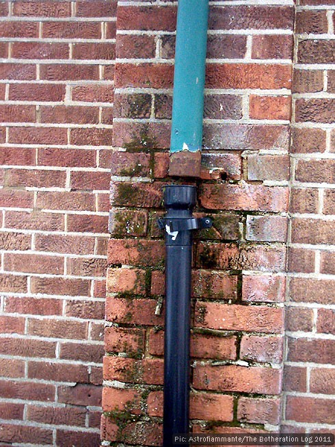 Disconnected drainpipe leaking onto brick wall