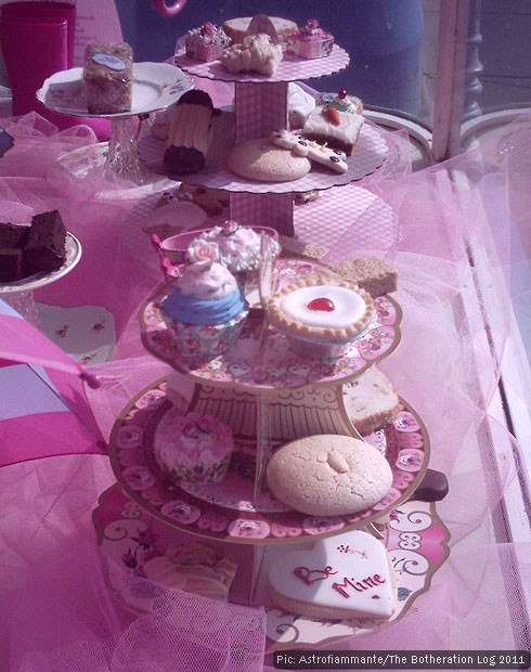 Cakes on a stand in a baker's window