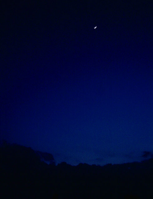 Crescent moon rising shortly after sunset