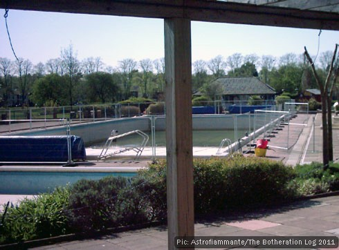 Open air pool being emptied for pre-season cleaning.