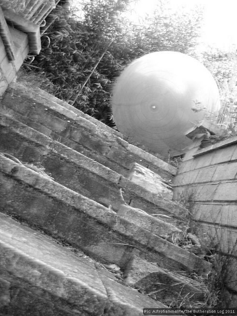 Large white ball descending a flight of steps
