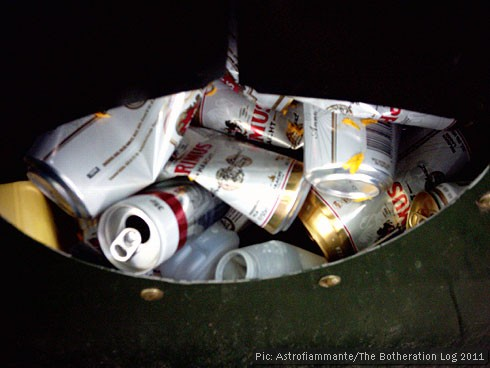 Beer cans in a recycling skip