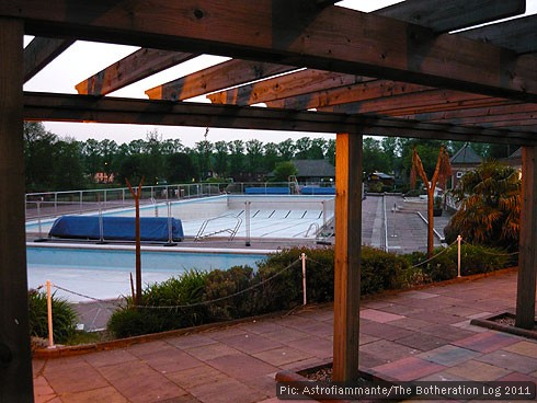 Open-air swimming pool standing empty