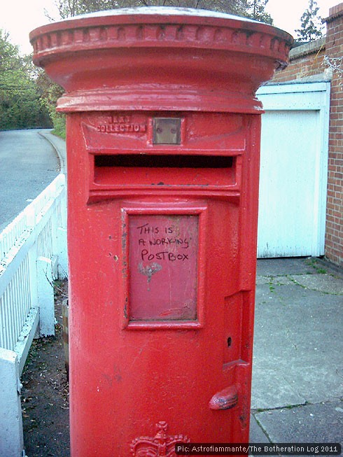 Red pillar box with message: 'This is a working post box'.