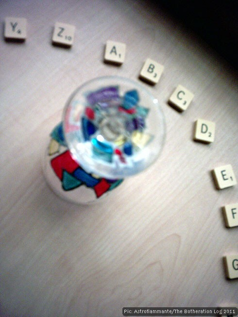 Wine glass in a circle of alphabetically-arranged Scrabble tiles