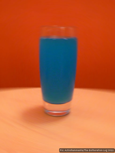 Blue energy drink pictured against an orange wall