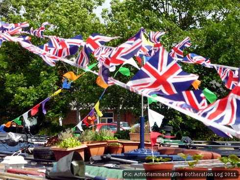 Bunting and potted plants on narrowboat rooves