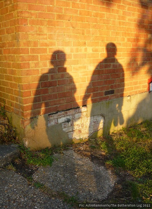 The shadows of two figures on a wall