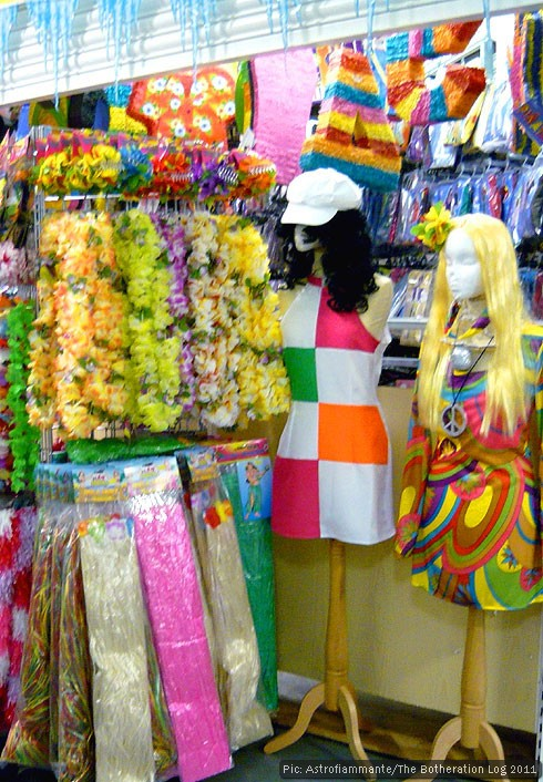 Fancy-dress market stall featuring 60s-style costumes