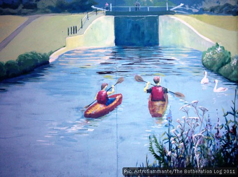 Mural showing canoeists on a canal