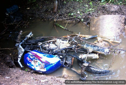 A wrecked motorbike in a culvert