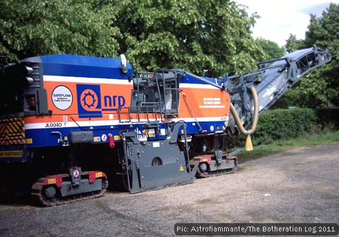 Road maintenance machinery stored in a car park