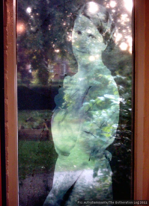 Semi-tramsparent picture of a woman superimposed on a view of a garden
