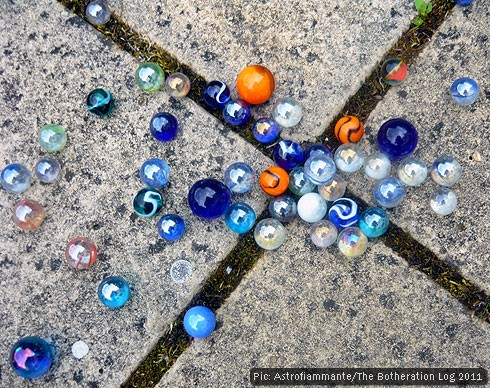 Glass marbles on paving stones