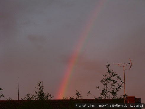 Late-evening rainbow over rooftops