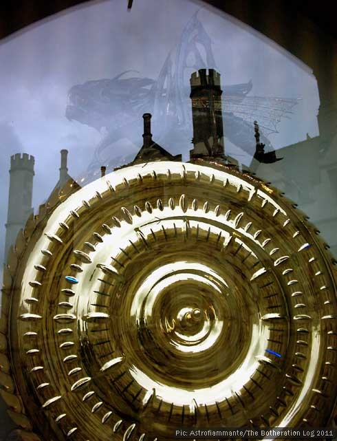 The Corpus Clock in Cambridge with reflected buildings