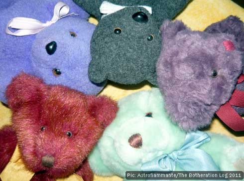 The heads of five teddy bears of various colours