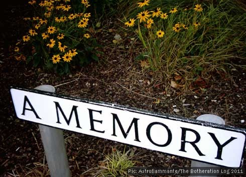 "A street sign reading: ""A Memory"""