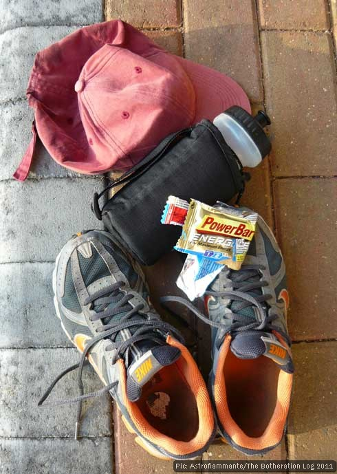 Running gear including shoes, hat, water bottle and energy bar