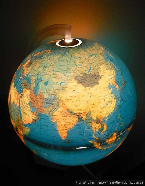 Illuminated globe lamp in use, showing India and Asia
