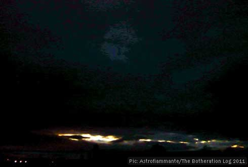 Streak of bright light in the west of a dark sky