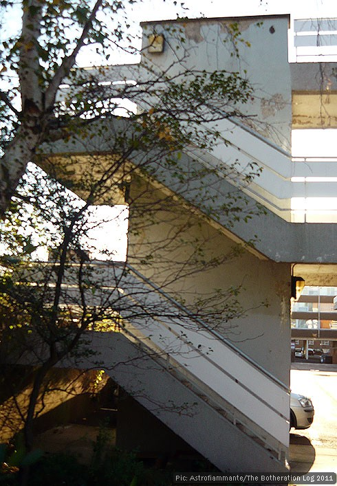 Concrete steps with parallel handrails winding around a central pillar