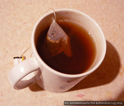 A mug of mint tea infusing