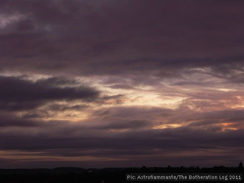 Rumpled purple clouds at sunset