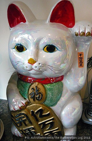 Chinese lucky cat with raised paw