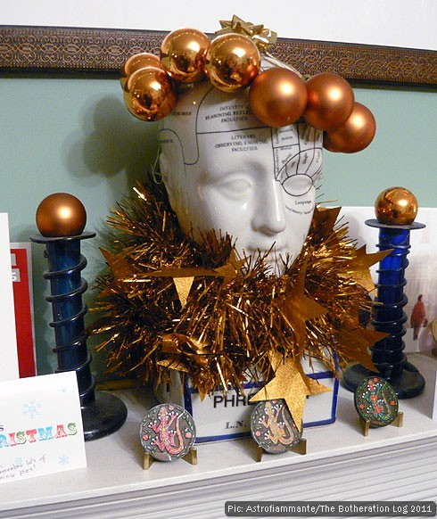 A phrenology head with a different set of Christmas decorations from the ones featured in our 2010/11 picture
