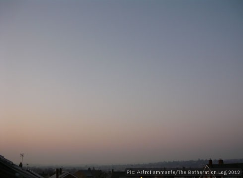Subdued pink and blue sunrise