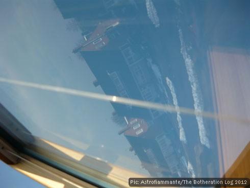 Snowy street reflected in skylight window