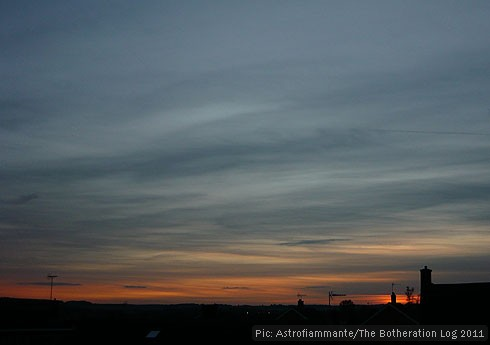 Grey-blue sky with cirrus cloud and remains of orange sunset
