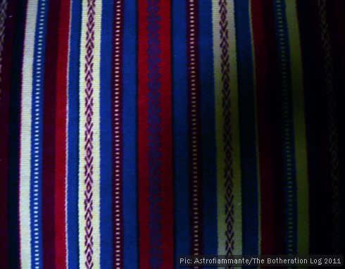 Vertical red, white and blue stripes on a woven rug