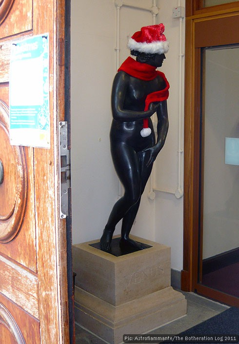 Bronze statue of Venus complete with Christmas hat and scarf