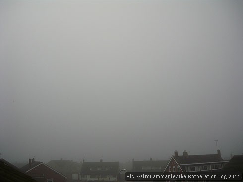 Foggy grey sky above rooftops