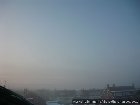 Misty sunrise on a snowy day